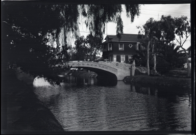 Bridge over canal, houses