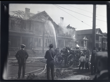 Steam fire engine, firemen, burning home, spectators