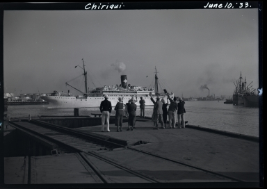 Chiriqui, United Fruit Company, in harbor, people waving from dock in foreground