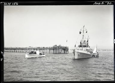 Cutter at anchor off Balboa pier, sailboat alongside