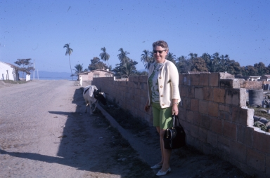 Woman standing in front of a wall.