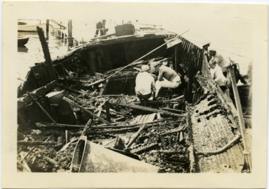 Wreckage of Yacht Yours Truly. Newport Beach Engine Co. # responded to fire alarm at 6:14 p.m. March 25, 1934.