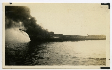 Schooner Muriel, being burnt to remove her from the Newport Harbor entrance.