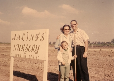 Ray, Larry and Anne Amling by sign put up before building was started.