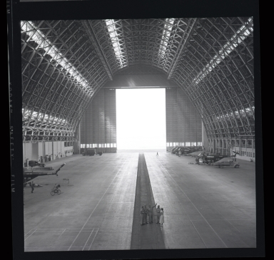 "Huge wooden blimp hangar built during World War II entirely of wood (to conserve strategic metal) and housed U.S. Navy ""Lighter-than-air"" blimps."