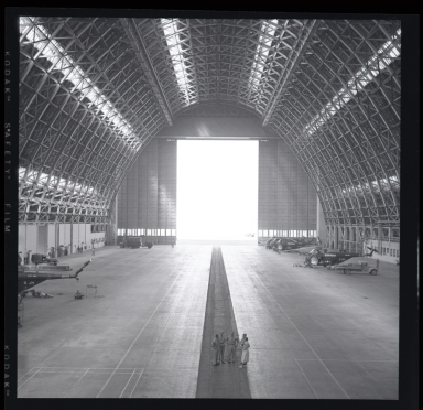 "Huge wooden blimp hangar built during WWII entirely of wood (to conserve strategic metal) and housed U.S. Navy ""Lighter-than-air"" blimps. The blimp was used for patrol along the west coast of California to watch for enemy submarines. At one time there were 4 blimps serviced and crews were billeted there at the Lighter-than-air Station in Santa Ana, near Tustin."