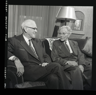 Portraits of Drs. C.C. Violett and Herbert A. Johnston at Orange County Medical Association's 65th anniversary party.