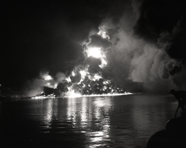 The burned-out hull of the tanker ship, Markay. The fire, which started about 9:00 p.m. with an explosion, destroyed the Union Oil Co. terminal and dockside terminal buildings. The tanker had been loading gasoline that was highly charged with butane gas to improve the antiknock quality of the fuel.