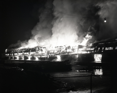 Union Oil Co. terminal and dockside terminal buildings burning after explosion of tanker, Markay.