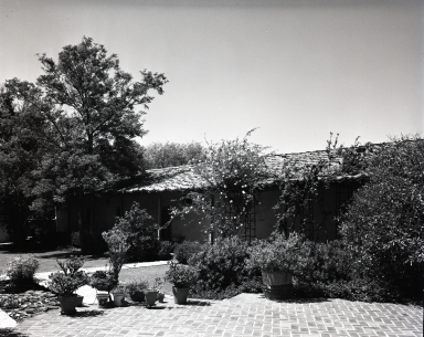 Exterior view of Rancho Los Cerritos. At this time the rancho was the home of the Bixby family (Mrs. Llewellyn Bixby had restored the building in 1933).
