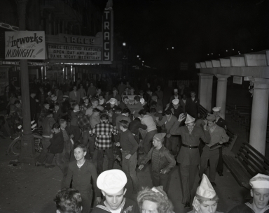 """""""The Pike"""" amusement zone: New Year's Eve Penny Scramble, when a penny was worth a scramble. At midnight, the Loof Management Co. of the Pike tossed handfuls of pennies to the awaiting crowds on the Pike."""