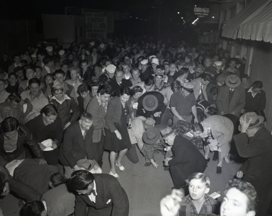 """""""The Pike"""" amusement zone: New Year's Eve Penny Scramble, when a penny was worth a scramble."""