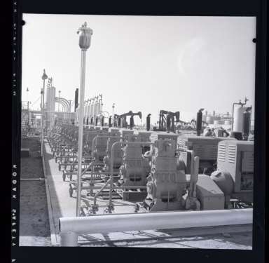 "Long Beach Harbor lease to Richfield. Along the west side of the Los Angeles River flood channel. A very consecrated production site. All pumps were underground and the ""silver tanks"" (sic) separators from oil & gas. 1946-48 period of harbor oil production and subsidence. (2 of 3)"