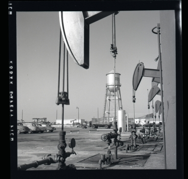 """Long Beach Harbor lease to Richfield. Along the west side of the Los Angeles River flood channel. A very consecrated production site. All pumps were underground and the """"silver tanks"""" (sic) separators from oil & gas. 1946-48 period of harbor oil production and subsidence. (3 of 3)"""