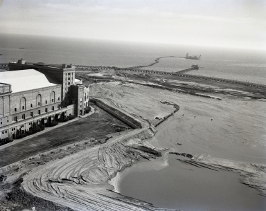 Filling in the lagoon around old Long Beach Auditorium. Rainbow Pier also pictured.