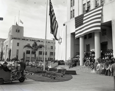 "Veterans Day ceremonies. Long Beach honors WW II dead (in flag-draped caskets) in front of the ""Old City Hall"" steps at Broadway and Pacific Ave. (November 11)"