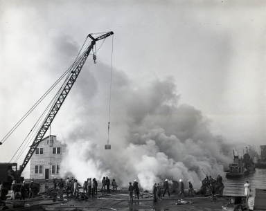 A fire under the pier (Berth 50) burned the wood pilings and flooring, and was extremely difficult to put out, lasting 4 days. After that, when the Long Beach Harbor Department rebuilt or added other piers they were solid concrete and heavy earth-fill.