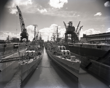 The Moreel Drydock at Long Beach Naval Shipyard is full of destroyers, Apa transports and oilers, all waiting for the dock to be pumped dry.