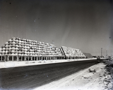 U.S. Naval Ammunition & Net Depot. Shown are giant piles of anti-submarine floats (spheres) and giant cylinders at the Net Depot. Many people were fearful because they thought the spheres were ocean mines. In reality, the floating steel spheres were made to hold up a net made of cable in the ocean around the breakwater entrances to Long Beach and Los Angeles harbors during WWII. Several Japanese subs tried to penetrate the harbor but were attacked and driven off. A derelict Japanese sub that periodically surfaced in the area was finally sunk off Catalina Island (1948-49)