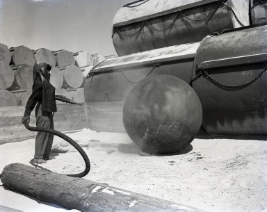 U.S. Naval Ammunition & Net Depot. Shown are giant piles of anti-submarine floats (spheres) and giant cylinders at the Net Depot.