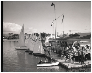 Dinghies docked at the Newport Harbor Yacht Club during the Pacific Coast Intercollegiate Races, Dinghy Championship.