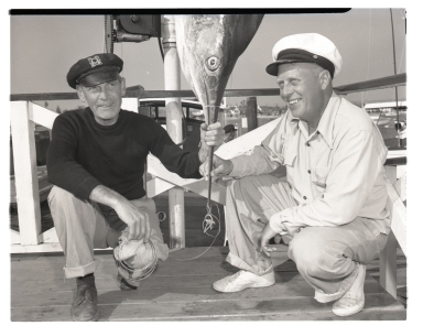 N. W. Hagelberg poses with a marlin he caught.