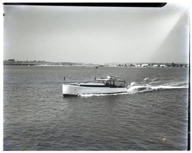 Motorboat <i>Suzette</i>, #27E275, anchored.