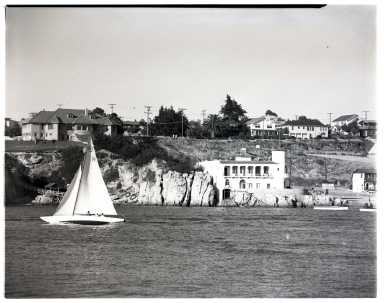 Hole House and Kerckhoff Lab viewed from the end of the Balboa Peninsula.  A motorboat appears in the the foreground.