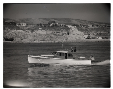 Motorboat <i>Jackilyn</i> in the entrance to Newport Harbor.