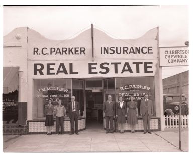 The R. C. Parker Real Estate office with the staff posing in front.