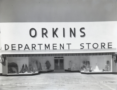 The storefront of Orkins Department Store.