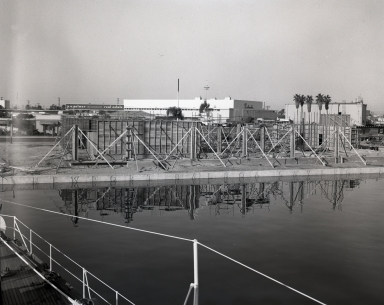 Construction of the Newport Balboa Savings and Loan building – walls and columns taken from the mast of the yacht Pioneer (649-651).