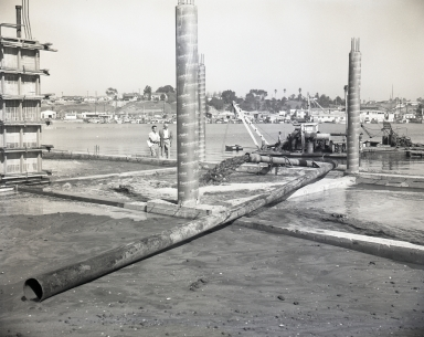 Construction of the Newport Balboa Savings and Loan building – backfill and forms (652-655).