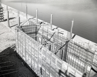 Construction of the Newport Balboa Savings and Loan building – pouring walls (656-659).