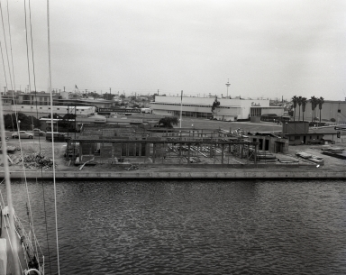 Construction of the Newport Balboa Savings and Loan building – ready to pour floor. View taken from the yacht Pioneer (665-666).