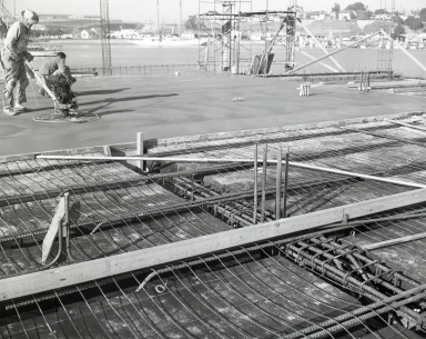 Construction of the Newport Balboa Savings and Loan - Pouring second floor (682-685).