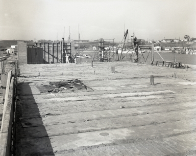 Construction of the Newport Balboa Savings and Loan building - second floor and columns (686-687).