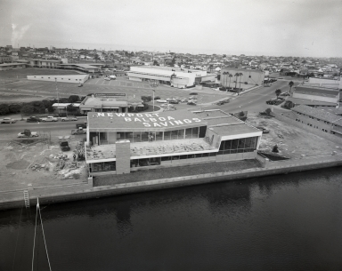 New Newport Balboa Savings and Loan building and Lido Shopping Center from the mast of the yacht Pioneer.