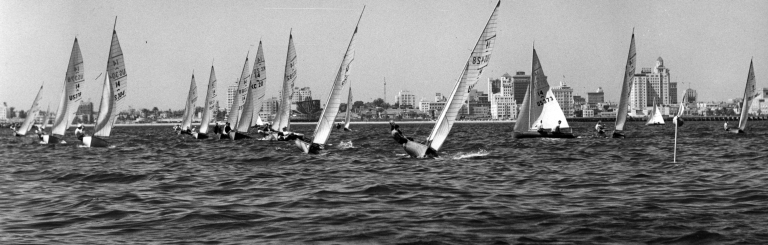 """""""Lido 14"""" Racing with Long Beach in Background"""